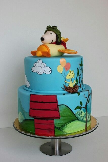 Snoops as WWI flying Ace on Top of Cake With Woody Holding Balloons