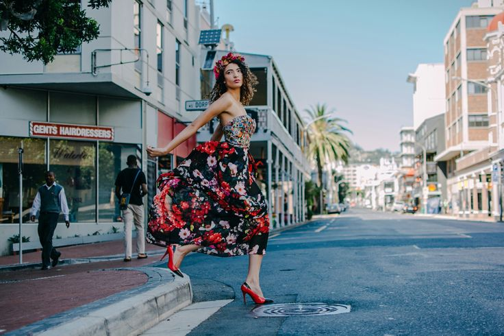 Cotton owl printed bodice with floral printed chiffon skirt.  Credits:  Model: Tayla Steyn. Photographer: Tina Hsu. Location: Long Street, Cape Town, South Africa