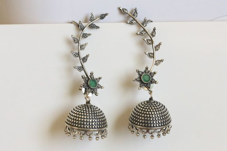 A pair of jaw dropping statement jhumka's in antique finish. Made with white metal, these earrings are exact replica of silver jhumka's at a very affordable price. Product details: Jhumka Height : 2 i