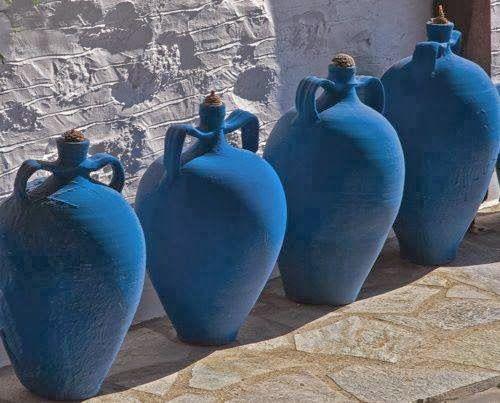 Blue urns against a white wall. Pinned to Garden Design - Contemporary Greek by Darin Bradbury.