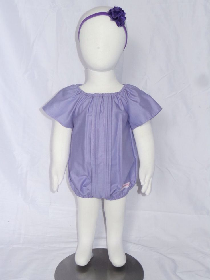 Tulip Playsuit. Features pin pleats on front, elastic neckline and legs for comfort and fit and snap fasteners at crotch for ease of nappy changes. Available in sizes 0000 - 4 in Lilac, white or pink for just $25. This style is available to be customised in your choice of colours and prints as well! Contact kerry@beanieboo.com.au to discuss options or order from website www.beanieboo.com.au.
