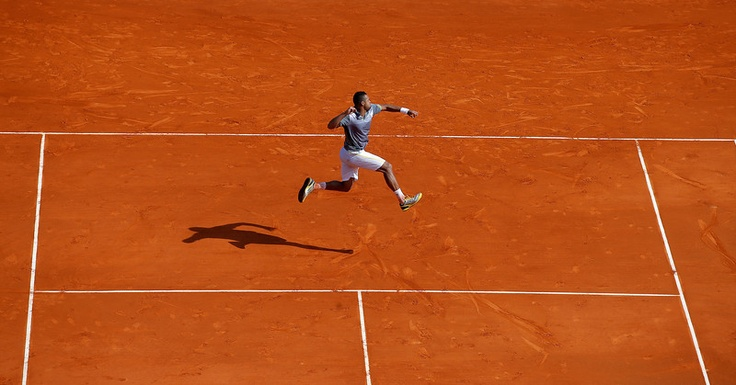 Frances Jo Wilfried Tsonga reacts after defeating Nikolay Davydenko in their match of the Monte Carlo Tennis Masters tournament in Monaco, Tuesday, April 16, 2013. (AP Photo/Lionel Cironneau)