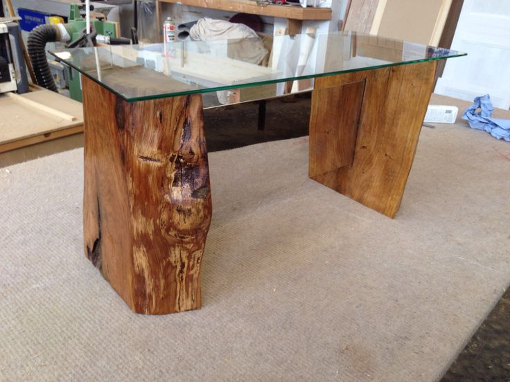 Table made from glass,wood and stainless steel