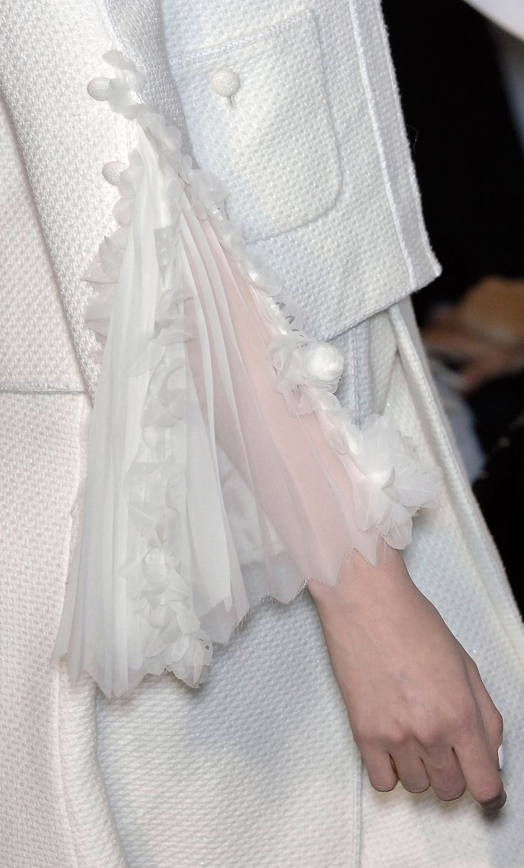 Elegant tailoring with delicate sheer fabric pleated sleeve insert; white on white fashion details // Chanel Haute Couture
