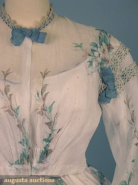 """Augusta Auctions, 2 piece white with green and brown floral pattern, trimmed with aqua ribbon & lace; bust: 40""""; waist: 29"""", front length: 42""""; back length: 53""""; period mends in skirt. sold in 2006 for 517 dollars."""