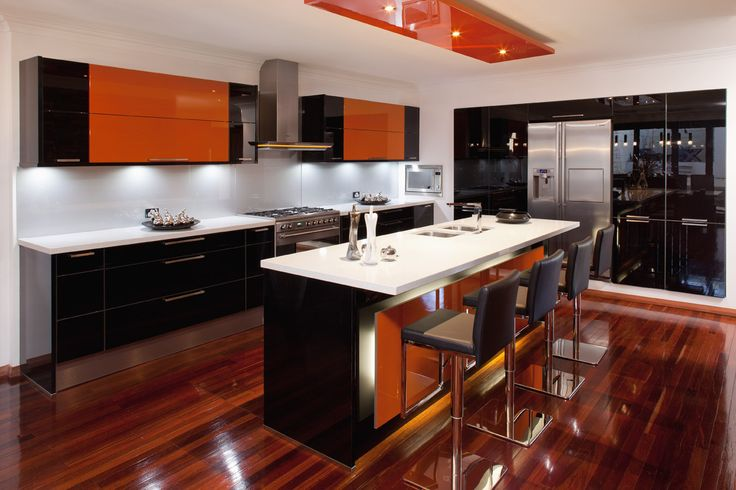 Luxury black and orange kitchen design by KitchenHaus