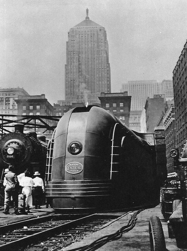 "New York Central Railroad streamlined ""Mohawk"" steam locomotive at LaSalle Street Station, Chicago, Illinois, 1939."