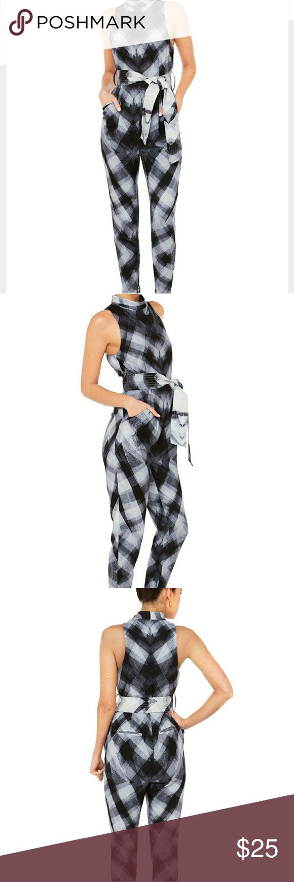 New! Cameo one piece Chicago  pant suit New with tag never used  Exclusive X-ray print,  zippers on inner ankle  Zipper back, includes belt Please feel free to ask questions  Approx 17.5 inches from pit to pit  26.5 inch inseam, 16 inch waist laying flat 2 front pockets cameo Pants Jumpsuits & Rompers