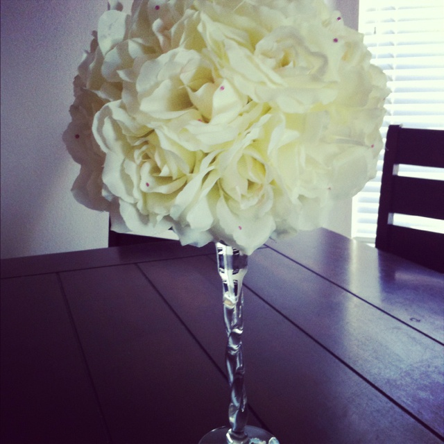 Silk flower centerpiece on candle holder for wedding or