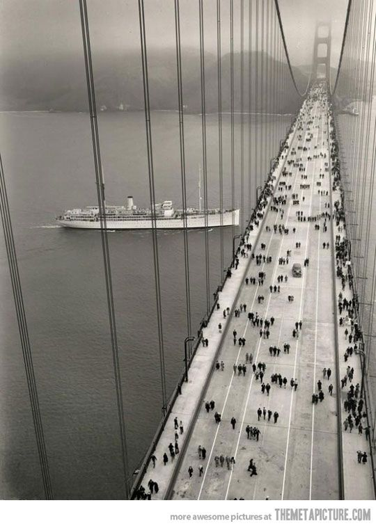 Traffic on the Golden Gate Bridge soon after it opened in 1937...funny it's all foot traffic.  Fantastic to see how marvelous this new bridge was to the people of 1937