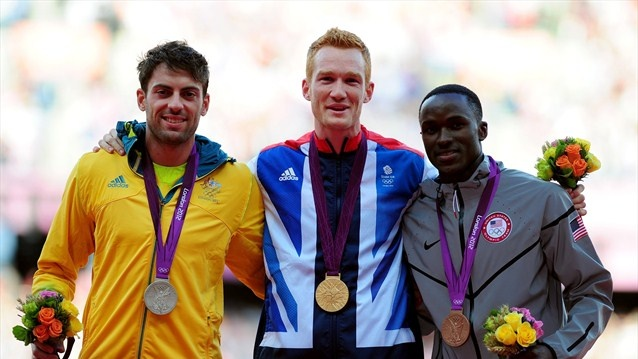 Silver medalist Mitchell Watt of Australia, gold medalist Greg Rutherford of Great Britain and bronze medalist Will Claye of the United States pose on the podium for Men's Long Jump on Day 9