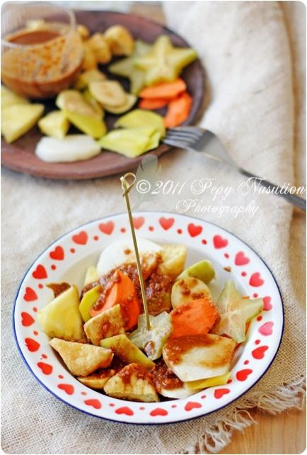 Rujak Manis. Indonesian fruid salad with sweet palm sugar sauce mix with peanut powder!!