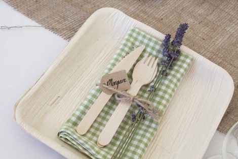 Bamboo plates and wooden cutlery with gingham napkins and lavender - rustic English country wedding