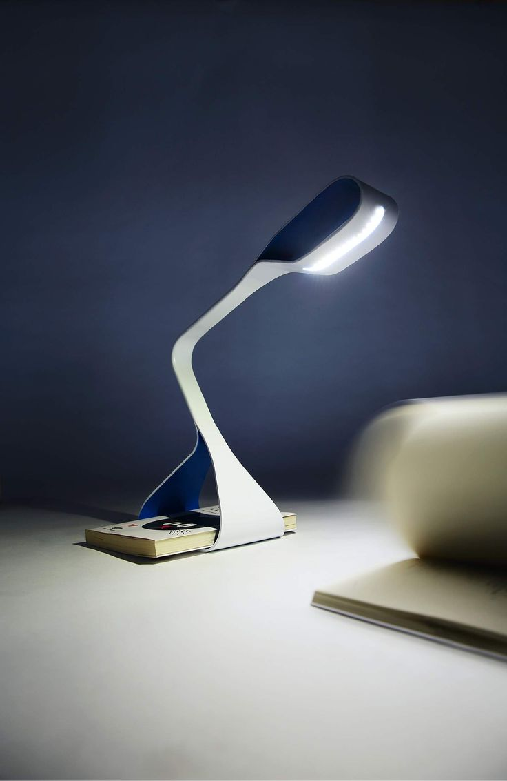Libra - Table Lamp - It is in need of a book. Otherwise it falls over. So from now on we are compelled to have a copy (already read) near us always.