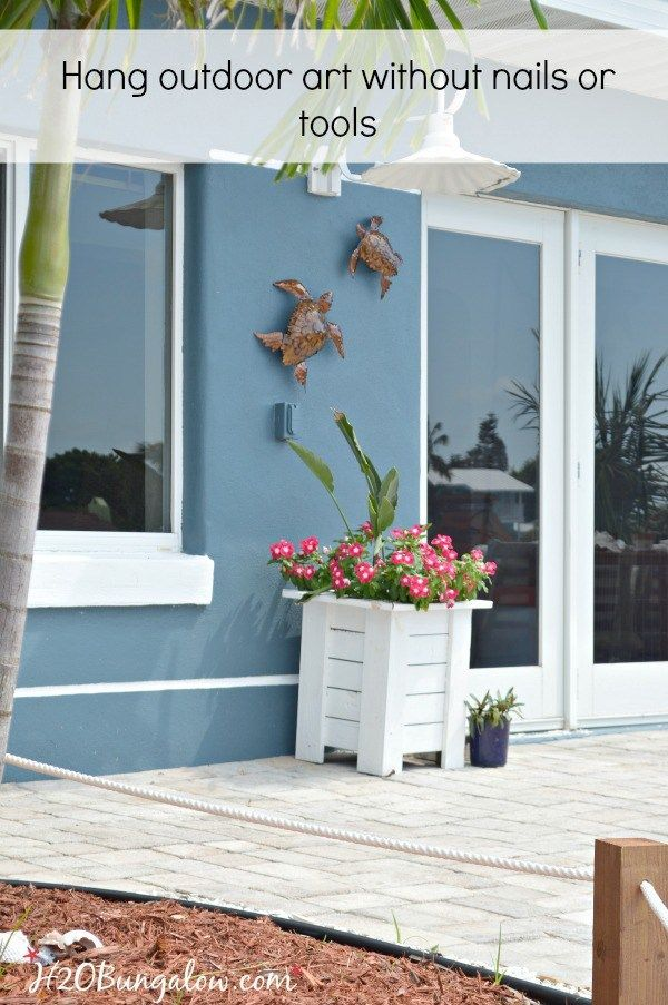 DIY tutorial to hang outdoor wall art without nails or tools on stucco, siding or any flat surface. Works great and it's a 10 minute project! H2OBungalow