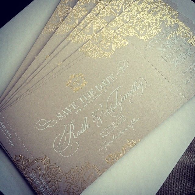 Gold foil boarding pass save the date for a destination wedding in Bali. (Airplane Ticket)