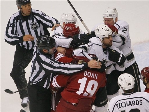 Phoenix Coyotes right wing Shane Doan (19) and Los Angeles Kings defenseman Willie Mitchell (33) have to be seperated during the third period of Game 1 of the NHL hockey Stanley Cup Western Conference finals, Sunday, May 13, 2012, in Glendale, Ariz. The Kings won 4-2. (AP Photo/Matt York)