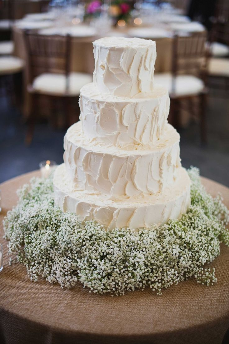 Simple White Four Layer Wedding Cake With Baby's Breath