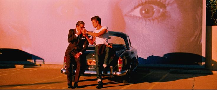 Shot from 'A Single Man' by Tom Ford. Great use of zoomed-in projection video in background.