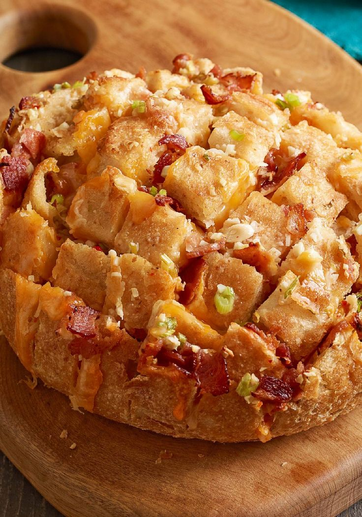 Cheesy Bread Pulls -- Made with a round sourdough bread loaf, these Cheesy Bread Pulls are a neat way to present friends and family with garlicky, bacon-studded goodness.