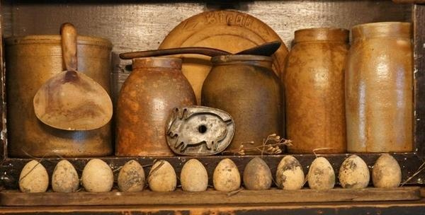 Crocks, jugs, and egg display with vintage cookie cutter