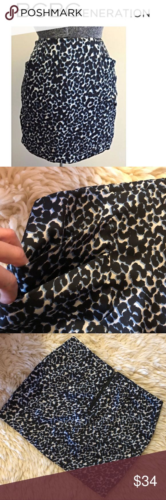 """BCBGeneration Blue Leopard Skirt White background with navy and lighter blue leopard print 🔹silky lightweight feel  🔹100% polyester  🔹lined 🔹Black exposed zipper on back  🔹double pockets on front  🔹size 8  Waist across 16"""" ; length top-bottom: 15""""  🔹condition NWOT BCBGeneration Skirts Mini"""