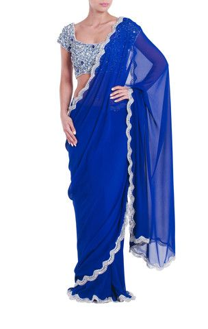 Seema Khan Deep blue saree featuring a sparkly border. Includes a contrasting silver and blue jewelled statement blouse. #SeemaKhan #Saree #Designer #Indianfashion