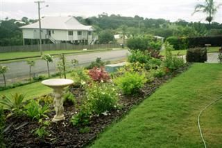 """Garden with Household Sewage Treatment systems - Ozzi Kleen - Testimonial: """"Great! No smell, No soggy trenches, good irrigation for my gardens"""". Grant Lucas, Peachester QLD"""