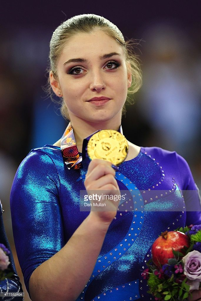 Olympics inspired makeup! Gold medalist Aliya Mustafina of Russia poses with the medal won in the Women's Individual All-Around final on day six of the Baku 2015 European Games at National Gymnastics Arena on June 18, 2015 in Baku, Azerbaijan.
