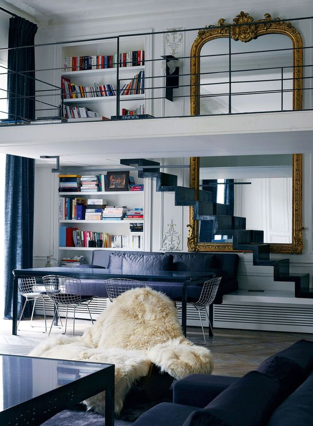 Isabelle Stanislas. love the scale of the antique mirror within this modern two-story interior.