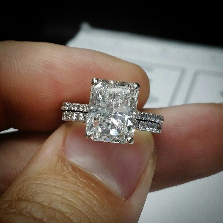 Here is a stunning example of a breathtaking large Radiant Cut Diamond Engagement Ring! The setting itself is a french pave set band of sparkling Round Brilliant Cut Diamonds! Stop by the office and see what we can do for you! www.diamondsforless.ca