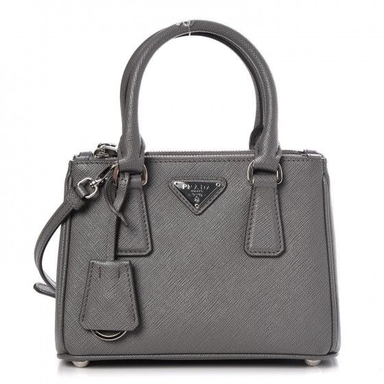 461e19bf8b795e This is an authenticPRADA Saffiano Lux Mini Galleria Double Zip Crossbody  Bag in Marmo. This chic tote is crafted of cross-grain leather in gray.