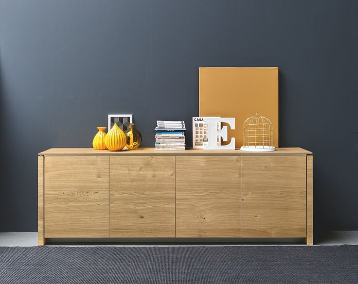 MAG Is The Three Doors Of The Sideboard Are Handle Less And Open By A