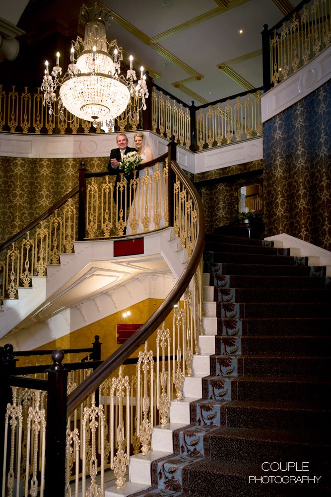 The bride & groom on the epic staircase at Killashee. Weddings at Killashee House Hotel photographed by Couple Photography.