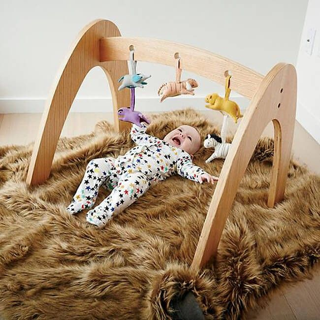 Natural Workout Baby Gym | Your baby can't do the pull-ups and leg crunches yet, but they love to lie on their backs and play with toys as a workout