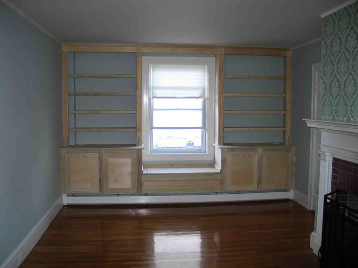 Built in bookcase around window and heater. This unit includes recessed lighting in the bookshelves.