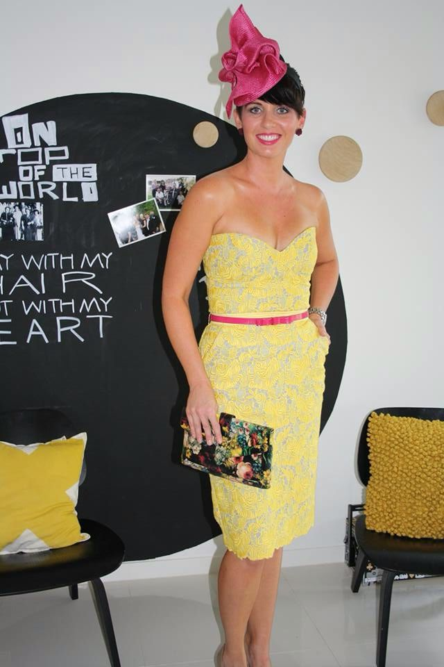 Yellow lace outfit. Skirt & strapless top. Racewear. Pink fascinator.
