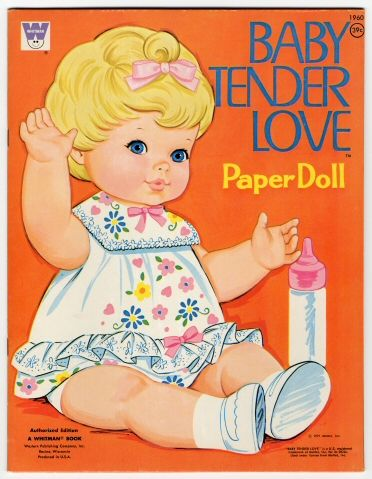 "I had/have a paper doll like this, only she had ""wigs"".  Baby Tender Love  paper doll  1971    Fashioned after the popular Mattel, Inc. doll, the Baby Tender Love paper doll set appeared thorughout the 1970s. the set featured the doll figure and 25 outfits and accessories to cut out and play with.  Manufacturer:  Whitman Publishing Co."
