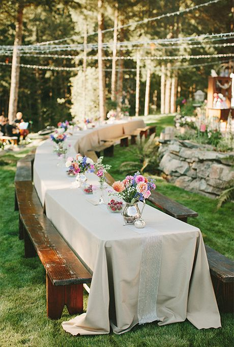long banquet reception table with slate tablecloth