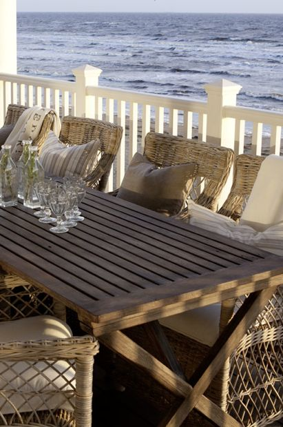 Colonial style, wicker chairs, porch, New England, classic garden, white fence.