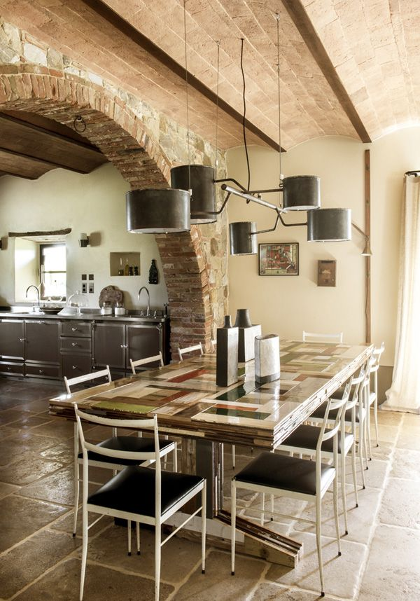 Atop a picturesque Tuscan hillside is this absolutely sublime stone and brick home that I have ...
