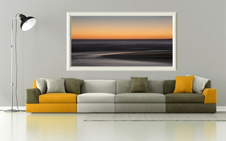 grey & orange living room with couch and example seascape