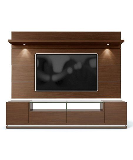 This TV stand comes with a panel featuring mounting hardware to hang your 70-inch flat screen television and complete your entertainment center using the roomy cubbies, drawers and shelves.