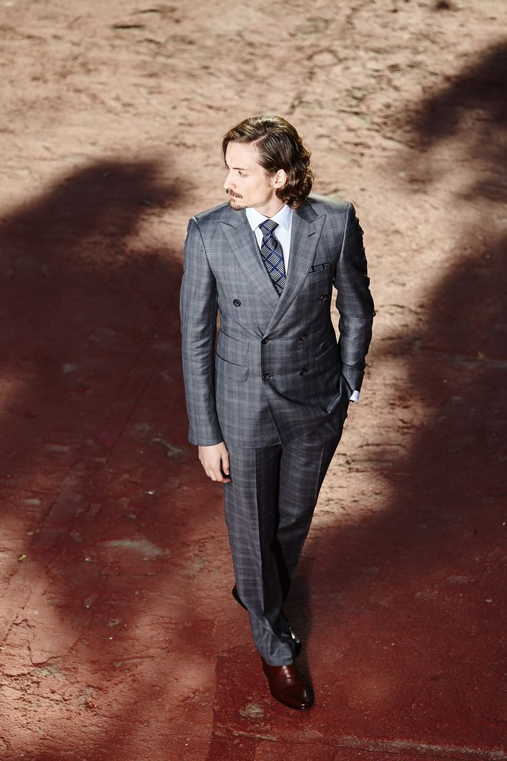 Men's grey double-breasted tailored two-piece suit.