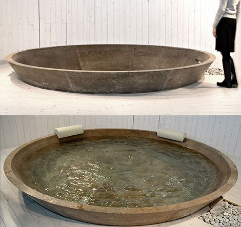 Oversize stone bathtub...now that I know this exists, I am reconstructing my dream bathroom..or adding onto the mental dreamhome.  Who doesn't need more bathrooms anyway?