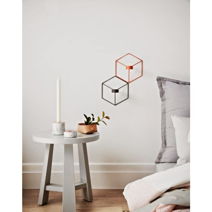 POV Candleholder Wall in Copper, is a modern wall-mounted candle holder, that can be used as a single piece or in a group, with a graphic look.