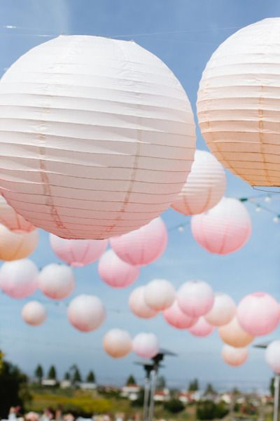 Pastel ombre paper lanterns: http://www.stylemepretty.com/2015/05/09/the-prettiest-ombre-wedding-details/