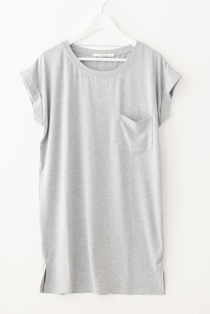 """Loose fittingt-shirt dress featuring a front chest pocket and small side slits. Cuffed short sleeves with a round neckline. Made with soft and stretchy jersey knit material. Size small measures approx. 34"""" in length. Available in grey or olive green.  60% Polyester 35% Rayon 5% Spandex Imported"""