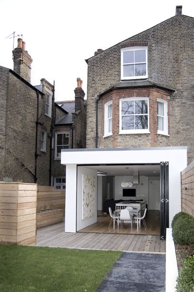 Old building with super modern addition. William-Tozer-Associates-accordion-door