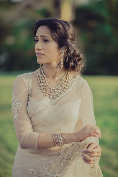 off white net saree, dull gold border embroidery, two layer diamond necklace, pearl drops, twisted messy bun from wedmegood